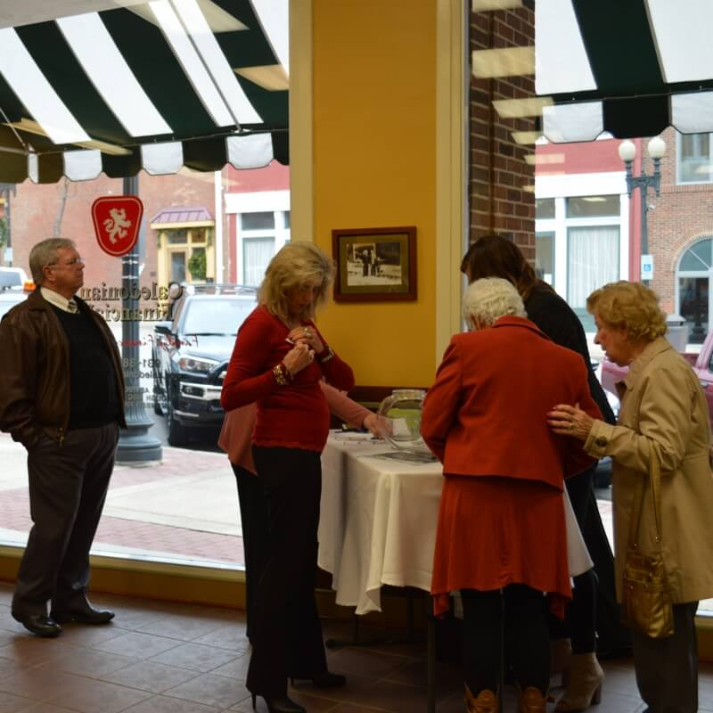 Signing in at the December Chamber Coffee